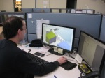 John Lord, CAD operator, looks over a client's design before submitting it to the manufacturing process.